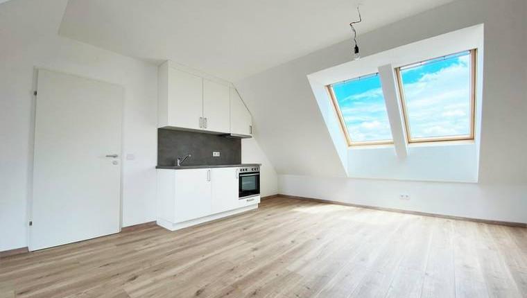 ERSTBEZUG: Sonniges Single-Appartement mit Dachterrasse